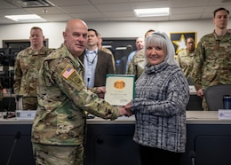 Col. Rodney H. Honeycutt, Chief of Staff, 1st Theater Sustainment Command (TSC), presents a time in service pin and certificate to Ms. Barbara E. Wright for her 15 years of service Feb. 28th, 2020 in Fort Knox, Ky.