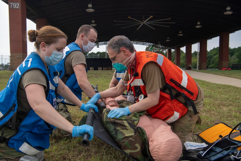 Medical Airmen simulate medical care during an exercise.