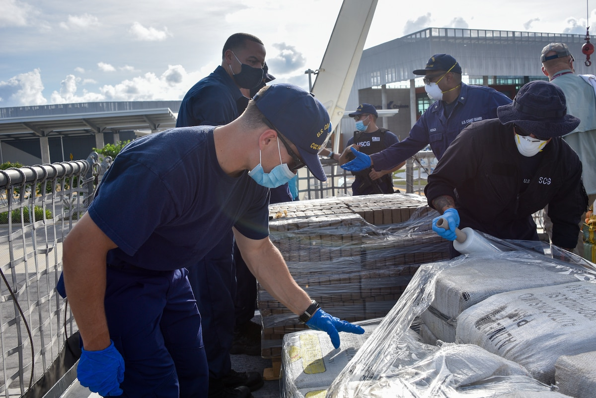 Crew members from Coast Guard Cutter Harriet Lane wrap pallets of drugs for offload at Port Everglades, Florida, Sept. 17, 2020.