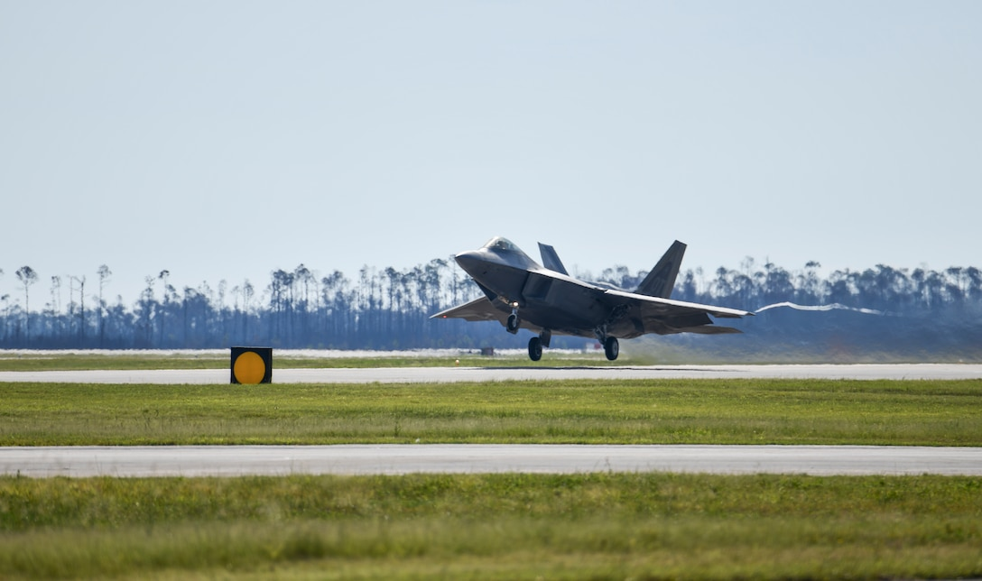 A U.S. Air Force F-22 Raptor Operational Test aircraft assigned to Nellis Air Force Base, Nevada, launches from the flight line at Tyndall Air Force Base, Florida, Sept. 18, 2020. The aircraft and aircrew participated in a Weapons System Evaluation Program held at Tyndall on behalf of Air Combat Command. (U.S. Air Force photo by Senior Airman Stefan Alvarez)