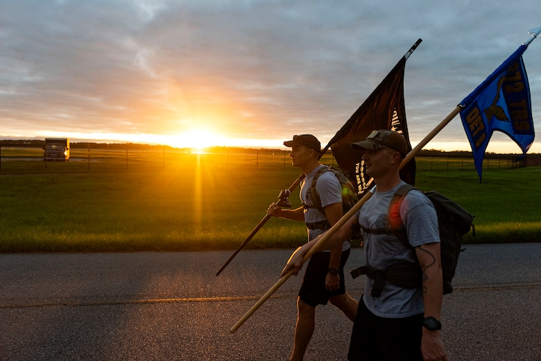 Photo of Airmen participating in a ruck march.