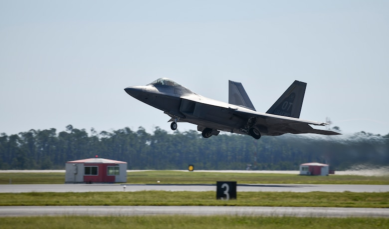 A U.S. Air Force F-22 Raptor Operational Test aircraft assigned to Nellis Air Force Base, Nevada, launches from the flight line at Tyndall Air Force Base, Florida, Sept. 18, 2020. Tyndall hosted a Weapons System Evaluation Program on behalf of Air Combat Command to utilize the invaluable air space over the Gulf of Mexico. (U.S. Air Force photo by Senior Airman Stefan Alvarez)