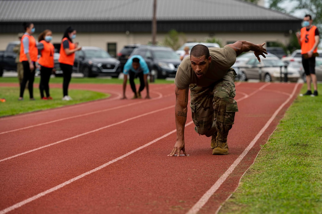 """Staff Sgt. Brandon Frank, 436th Logistics Readiness Squadron material manager, prepares to start the """"fastest human"""" quarter-mile sprint during the Fall Wingman Day Series Sept. 17, 2020, at Dover Air Force Base, Delaware. This Wingman Day series focused on reflecting and connecting through strengthening mental and physical skills. (U.S. Air Force photo by Airman 1st Class Faith Schaefer)"""