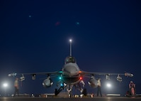 Airmen prepare an aircraft for take-off on the flight line.