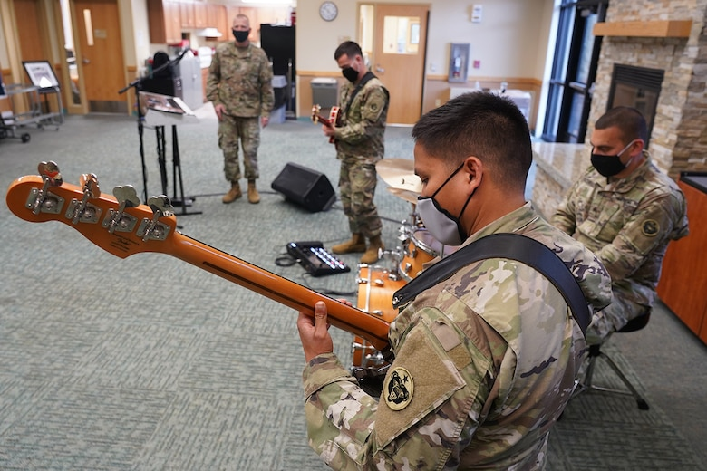 Army Sgt. Johndavid Untalan, a native of Dededo, Guam, and a bassist assigned to the 9th Army Band, 17th Combat Sustainment Support Battalion, U.S. Army Alaska, rehearses with fellow Soldiers in an open room at their unit headquarters on Joint Base Elmendorf-Richardson, Alaska, Sept. 17, 2020.