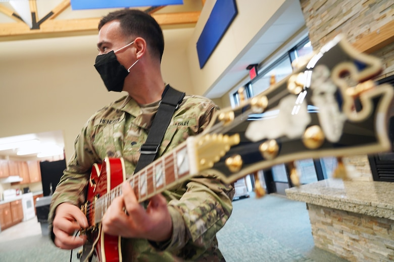 Army Spc. William Hendrix, a native of Greenville, SC, a guitarist assigned to the 9th Army Band, 17th Combat Sustainment Support Battalion, U.S. Army Alaska, rehearses in an open room at his unit headquarters on Joint Base Elmendorf-Richardson, Alaska, Sept. 17, 2020.