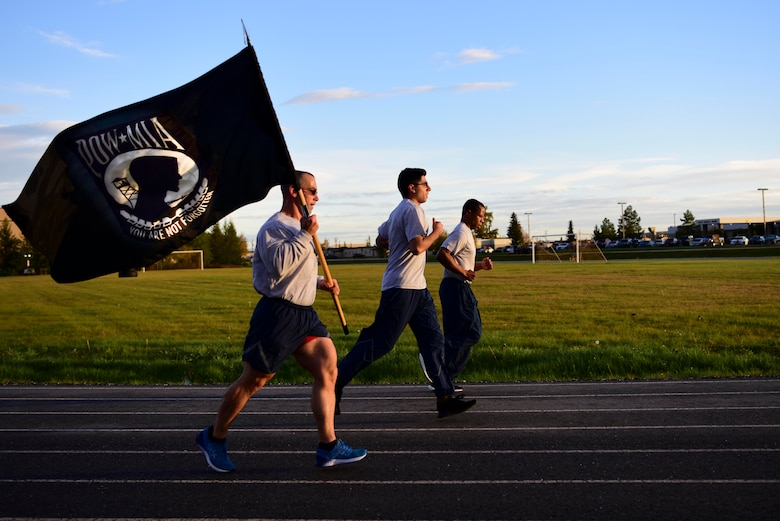 U.S. Air Force Airmen assigned to the 354th Force Support Squadron participate in a POW/MIA 24-hour Remembrance run at the outdoor track on Eielson Air Force Base, Alaska, Sept. 18, 2020.