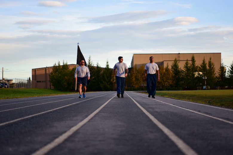 U.S. Air Force Airmen assigned to the 354th Force Support Squadron walk on the track during the POW/MIA 24-hour run on Eielson Air Force Base, Alaska, Sept. 18, 2020.