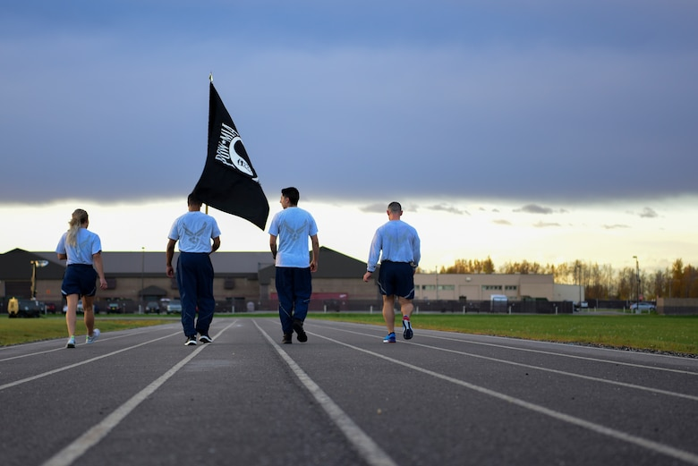 U.S. Air Force Airmen assigned to the 354th Force Support Squadron walk their last lap on the track during the POW/MIA 24-hour run at Eielson Air Force Base, Alaska, Sept. 18, 2020.