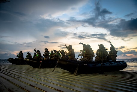 PHIILIPPINE SEA (Sept. 11, 2020) Marines with Battalion Landing Team, 2nd Battalion, 4th Marines, 31st Marine Expeditionary Unit (MEU) debark USS New Orleans (LPD 18) during a boat raid exercise.