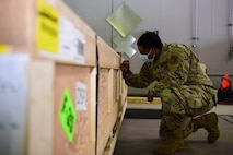 U.S. Air Force Staff Sgt. Rodney Vinson, a 354th Logistics Readiness Squadron fleet management and analysis journeyman, labels a crate during Arctic Fox 20-2 on Eielson Air Force Base, Alaska, Sept. 15, 2020. Finding the item's center of balance helps out loadmasters in their load planning for an aircraft. (U.S. Air Force photo by Airman 1st Class Jose Miguel T. Tamondong)