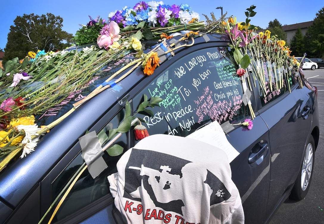 Flowers and messages cover Senior Airman Jason Phan's vehicle in the long-term parking lot at Hanscom Air Force Base, Mass., Sept. 16. Phan, a 66th Security Forces Squadron entry controller, was killed in a non-combat related accident while serving overseas, Sept. 12. (U.S. Air Force photo by Linda LaBonte Britt)