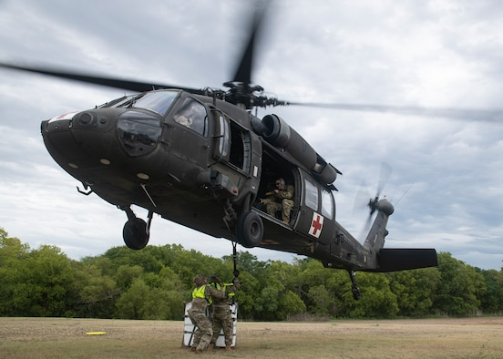 Airmen assigned to the 74th Aerial Port Squadron rig equipment to a UH-60 Black Hawk helicopter during a rigging practice mission Sept. 9 at Joint Base San Antonio-Medina.