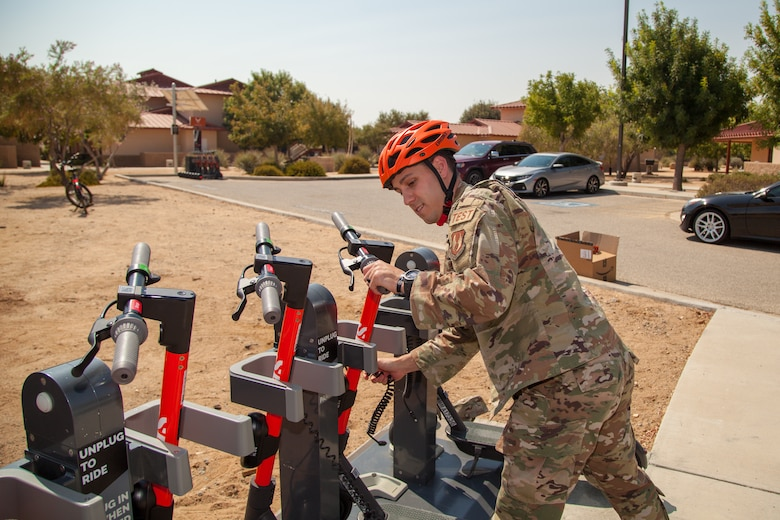 Master Sgt. Chad Hardesy, 412th Security Forces Squadron, demonstrates the new Spin scooters near the Airmen dormitories at Edwards Air Force Base, California, during the projects launch Sept. 2. (Air Force photo by Ethan Wagner)
