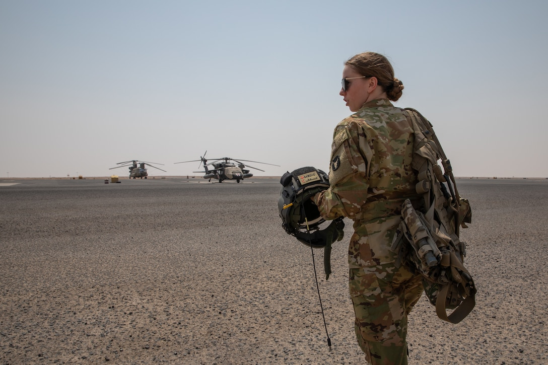 U.S. Army Sgt. Kayla Sampson walks out to a UH-60 Black Hawk July 30, 2020, to perform the daily pre-flight checks required for every MEDECAV aircraft to ensure they are ready to take flight at a moments notice. Sampson is deployed to Camp Buehring, Kuwait with Charlie Company, 2-238th General Aviation Support Battalion, and as a flight medic performing all in-flight medical attention to patients during transport. (U.S. Army photo by Sgt. Sydney Mariette)