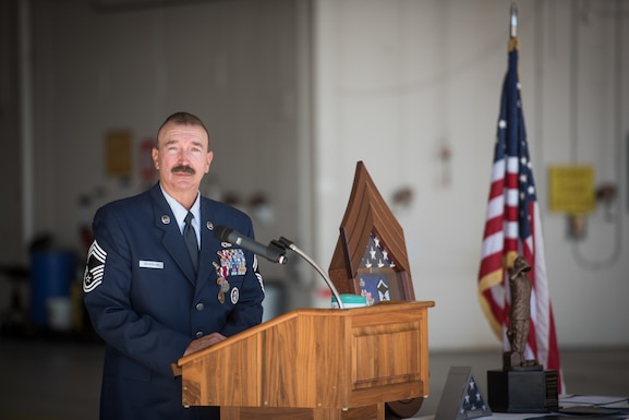 Chief Master Sgt. Scotty Seiverling speaks during his retirement ceremony.