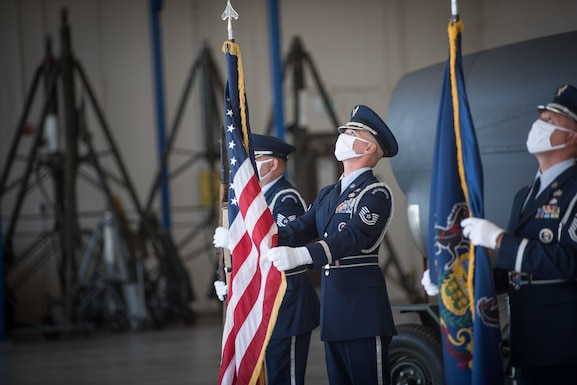 Airmen from the 193rd Special Operations Wing Honor Guard post the colors during a retirement ceremony.