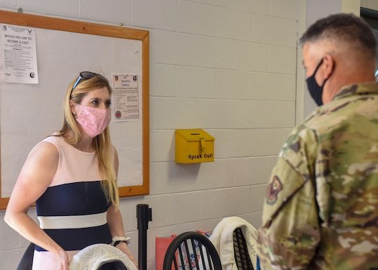 Jolene Richardson (left), 193rd Special Operations Wing director of psychological health, speaks with an Airman during a suicide prevention month activity at the wing dining facility Sept. 19, 2020. Airmen were asked to write encouraging notes to be placed on a wall to collectively demonstrate building a wall of support. (Air National Guard photo by Staff Sgt. Rachel Loftis/Released)