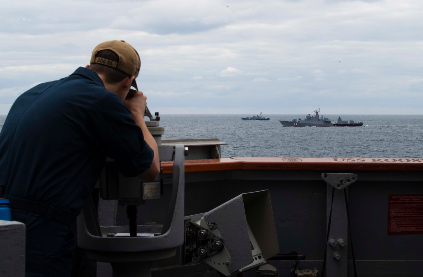 BLACK SEA (Sept. 20, 2020) Quartermaster 2nd Class Daniel A. Draughon takes the bearing of Bulgarian Navy Koni-class frigate BGS Smeli (F-11) and BGS Bodri (F-13) as they participate in a passing exercise with the Arleigh Burke-class guided-missile destroyer USS Roosevelt (DDG 80), Sept. 20, 2020. Roosevelt, forward-deployed to Rota, Spain, is on its first patrol in the U.S. Sixth Fleet area of operations in support of regional allies and partners and U.S. national security interests in Europe and Africa.