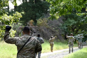 Photo of Airmen performing fire team drills during Fieldcraft Contingency Response training.