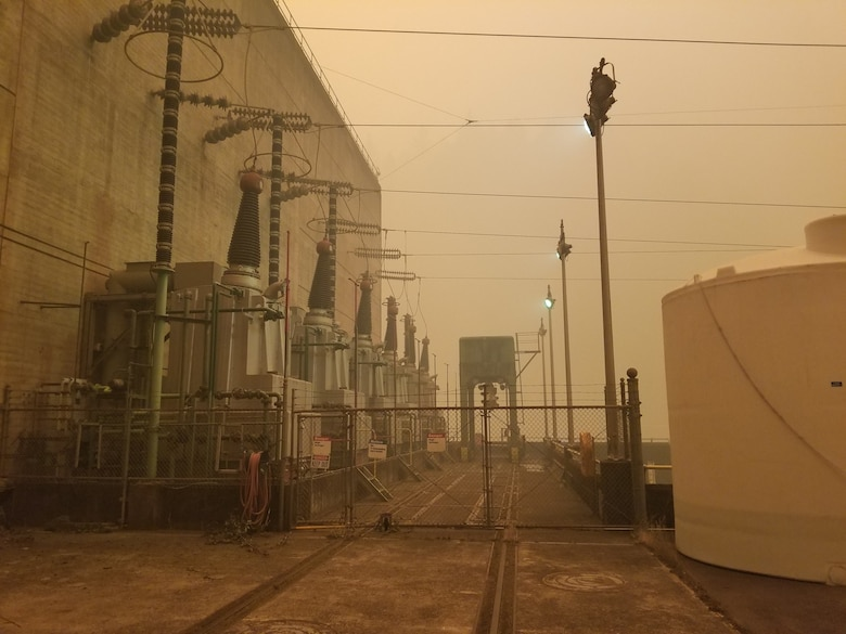 Photos of buildings, surrounded by wildfire smoke.