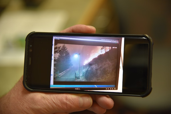 A photo of security camera footage of the Beachie Fire approaching Detroit Dam.