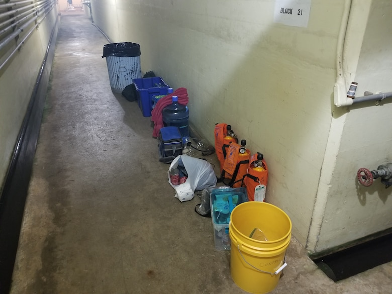 A photo of a bucket, breathing apparatus and other items that Mike Pomeroy staged inside the dam.