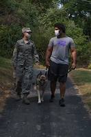 Tech. Sgt. Allissa Landgraff, NCO in charge of media operations with the 911th Airlift Wing, and Noel Cesar, student at the New York Film Academy, walk their dog Athena at the Pittsburgh International Airport Air Reserve Station, Pennsylvania, Sept. 14, 2020.