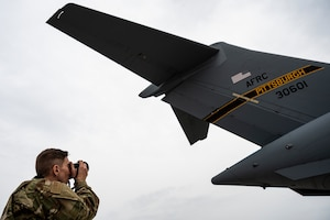 Tech. Sgt. Ben Rush, 911th Force Support Squadron services specialist, takes a photo of a  C-17 Globemaster III at the Pittsburgh International Airport Air Reserve Station, Pennsylvania, Sept. 17, 2020.