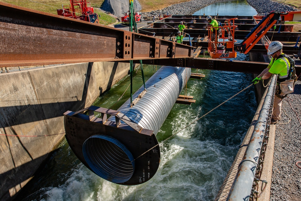 Contractors work to install a pipe to re-route water in the stilling basin at Foster J. Sayers Dam in Centre County, Pennsylvania, Aug. 19, 2020. (U.S. Army photo by Christopher Fincham)