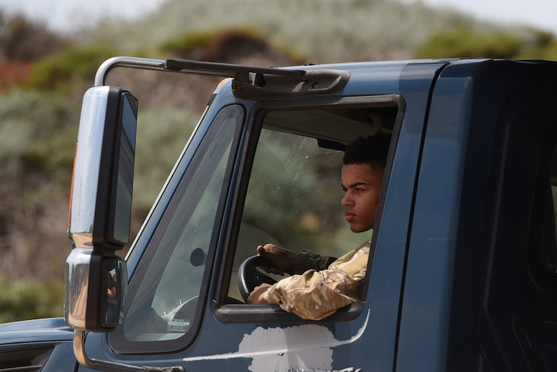 Airman 1st Class Cortez Terrell, 30th Civil Engineer Squadron heavy equipment operator, drives a truck delivering dirt for the gaseous nitrogen pad Aug. 18, 2020, at Vandenberg Air Force Base, Calif. The pad will be used to bed-down trucks and trailers outfitted with nitrogen production equipment to supply gaseous nitrogen for upcoming ULA Delta Heavy launches. (U.S. Air Force photo by Senior Airman Hanah Abercrombie)
