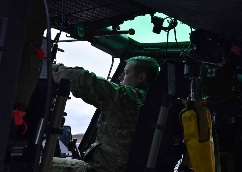 U.S. Air Force Capt. Joel Lewis, 36th Rescue Squadron executive officer, prepares a Bell UH-1N Iroquois helicopter for flight at Fairchild Air Force Base, Washington, Jan. 30, 2020. Lewis and two other Airmen from the 36th RQS flew over the Survival, Evasion, Resistance and Escape school to hoist 40 SERE students. (U.S. Air Force by Airman 1st Class Kiaundra Miller)