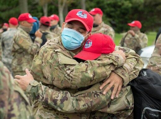 Two airmen hug