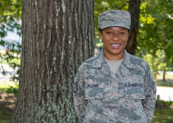 A female Airman poses for a photo