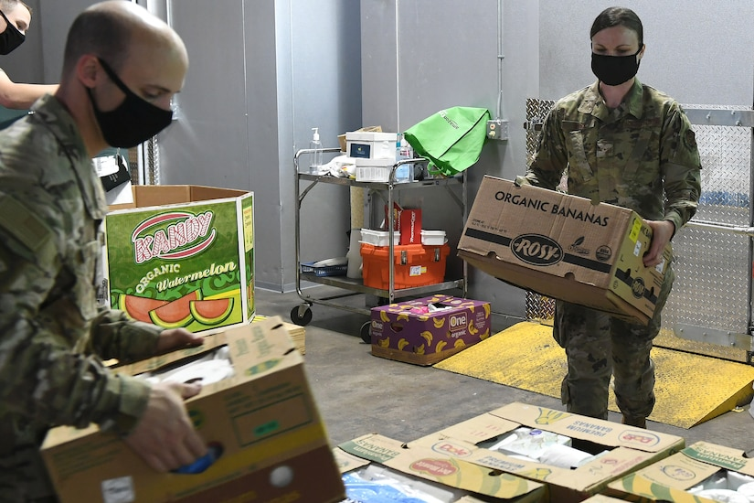 An airman working at a food bank.