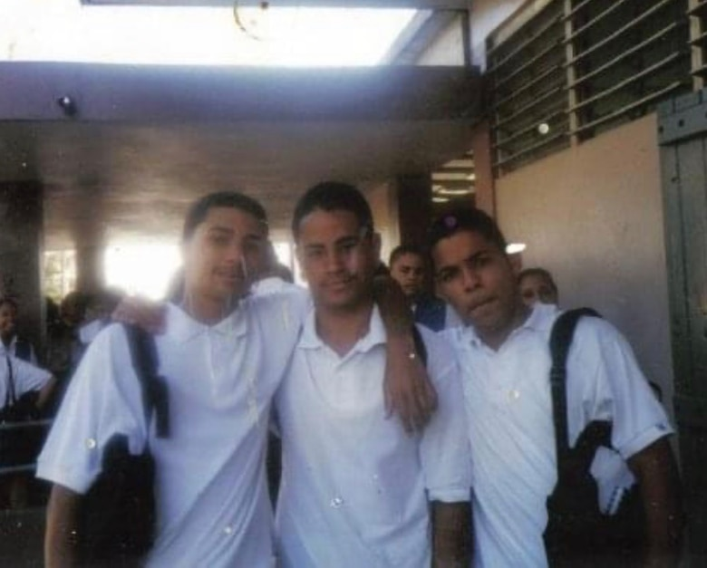 A young Master Sgt. Heriberto Mercado Rodriguez, 27th Special Operations Logistics Readiness Squadron C-130 aircraft parts storage section chief, (middle) takes a photo with his friends in high school at San Juan, Puerto Rico. Despite his teacher's words, Mercado graduated high school and continued on to graduate college. (Courtesy Photo)