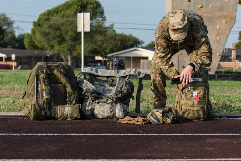 """Col. Craig Prather, 47th Flying Training Wing commander, prepares his gear for the ruck competition around the base perimeter in celebration of the Air Force's 73rd birthday on Sept. 18, 2020, at Laughlin Air Force Base, Texas. """"Today is more than just the United States Air Force's 73rd birthday,"""" said Chief Master JoAnne S. Bass, Chief Master Sergeant of the Air Force, in a shared Facebook post. """"Today is an opportunity to reflect on where we came from, how we got here and where we are going."""" (U.S. Air Force photo by Senior Airman Anne McCready)"""