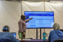 A Military Health System GENESIS trainer demonstrates how to operate the system at Eielson Air Force Base, Alaska, Sept. 16, 2020.