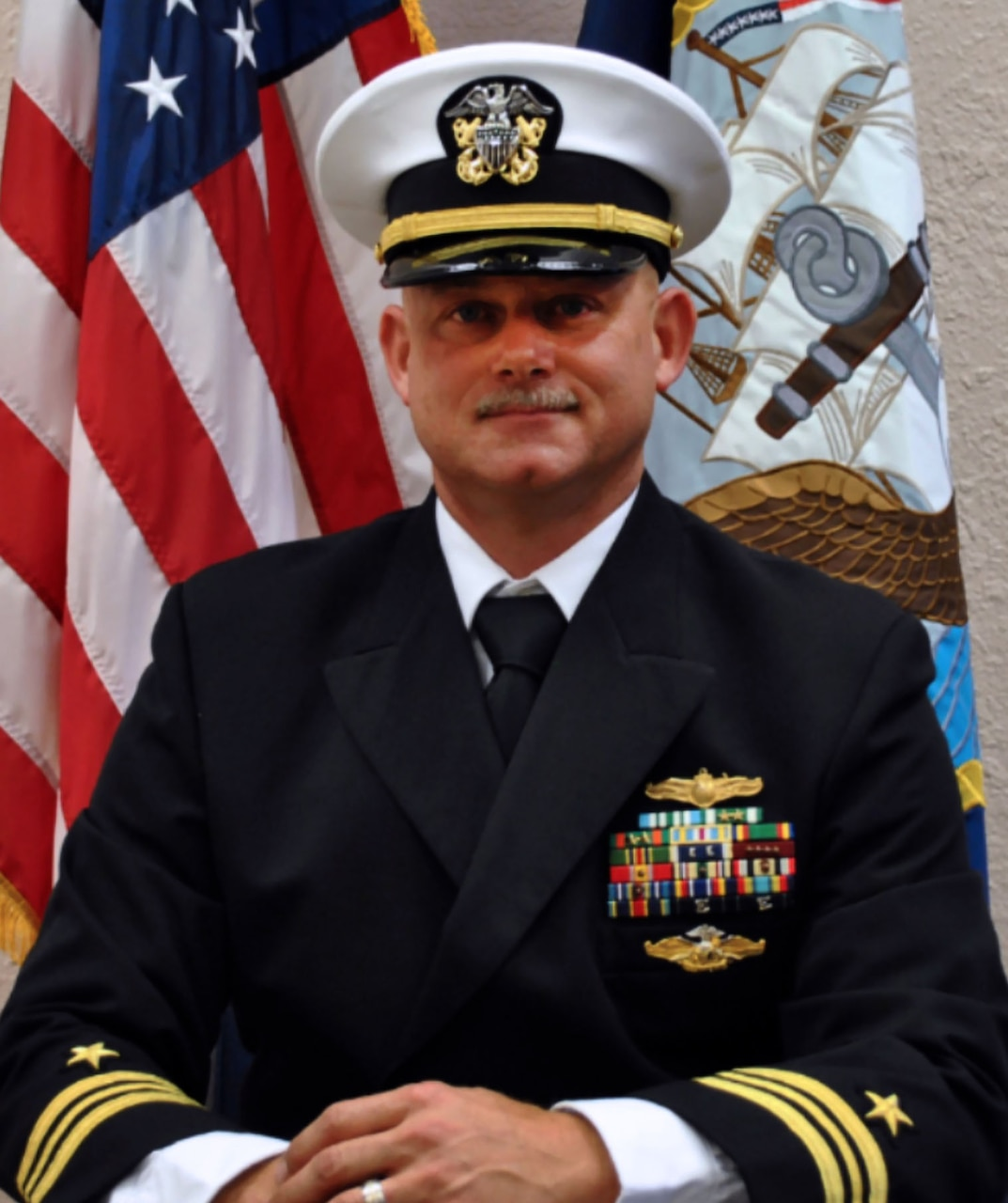 Official portrait of Lt. Cmdr. Gilbert R. Baughn, the officer-in-charge of Naval Computer & Telecommunication Area Master Station Detachment Jacksonville.