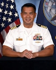 Official portrait of Capt. Vincent S. Tionquiao, the commanding officer of Naval Computer and Telecommunication Area Master Station (NCTAMS) Pacific.