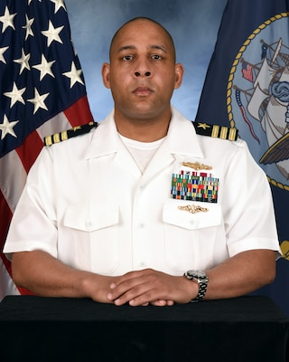 Official portrait of Cmdr. Victor T. Taylor, the chief staff officer and executive officer Naval Computer and Telecommunication Area Master Station (NCTAMS) Pacific.