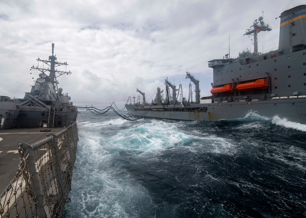 The guided-missile destroyer USS Paul Hamilton (DDG 60) conducts a replenishment-at-sea with the Military Sealift Command fleet replenishment oiler USNS Yukon (T-AO 202) in the Arabian Sea.