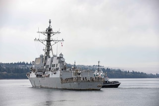 The Guided-missile destroyer USS Kidd (DDG 100) pulls into its homeport of Naval Station Everett.