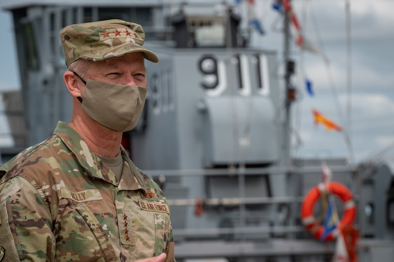 U.S. Air Force Gen. Mark Kelly, Commander of Air Combat Command, looks over the ships docked in Third Port.