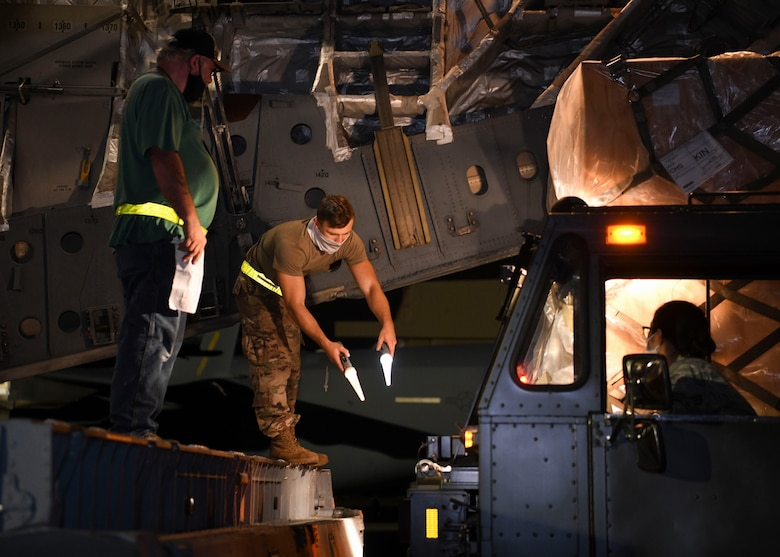 Ramp service technicians assigned to the 437th Aerial Port Squadron load a mobile field hospital onto a C-17 Globemaster III at Joint Base Charleston, S.C., Sept. 19, 2020. Aircrew assigned to the 15th Airlift Squadron transported the large mobile hospital to Kingston, Jamaica, Sept. 19, where it will be used to support the Caribbean nation's ongoing response to the COVID-19 pandemic. The donation, made on behalf of the American people, cost $753,000 and is part of U.S. Southern Command's ongoing assistance to nations responding to the global pandemic in the Caribbean and Latin America funded by the command's Humanitarian Assistance Program (HAP). The command has also delivered mobile field hospitals to Costa Rica and the Dominican Republic and, in total, will donate 24 field hospitals to 11 countries. (Photo by Staff Sergeant Lance Valencia)