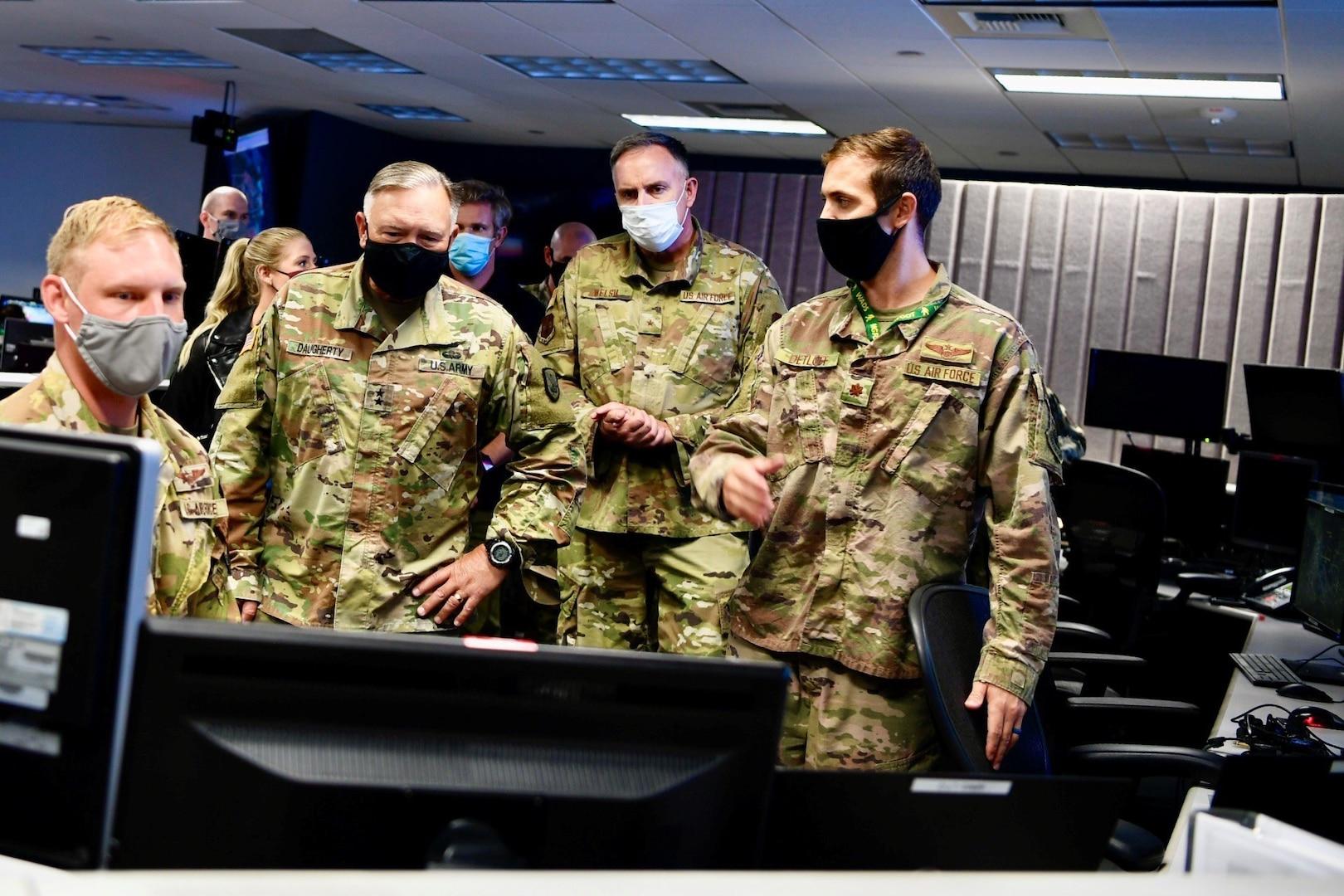 U.S. Army Maj. Gen. Bret Daugherty, adjutant general, Washington National Guard, second from left, and U.S. Air Force Brig. Gen. Gent Welsh, commander, Washington Air National Guard, second from right, observe software demonstrations during an Advanced Battle Management System (ABMS) onramp event at Joint Base Lewis-McChord, Wash., Sept. 2-3, 2020.