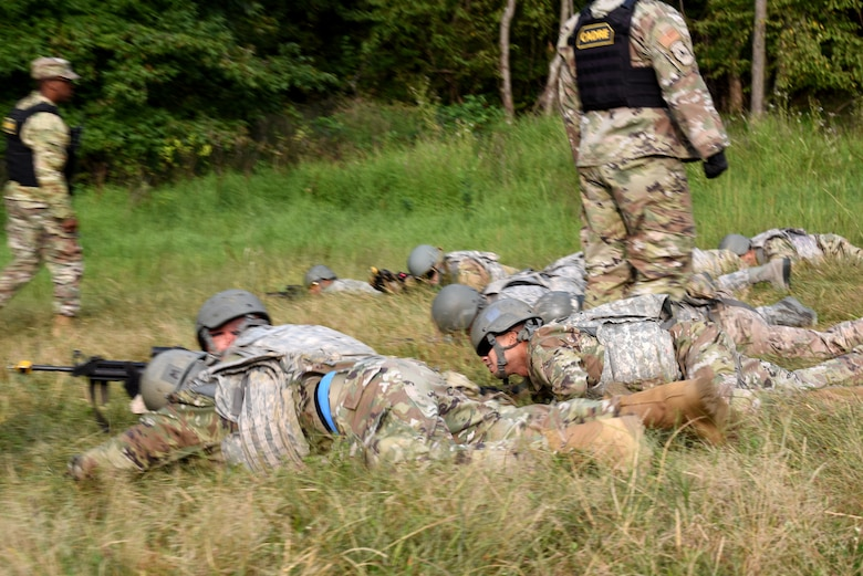 Photo of Airmen performing tactical movement drills during Fieldcraft Contingency Response training.