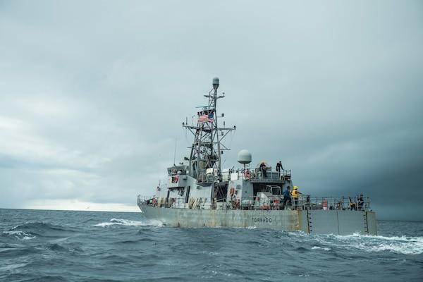 The Cyclone-class coastal patrol ship USS Tornado (PC 14) conducts a man overboard drill Sept. 16, 2020.