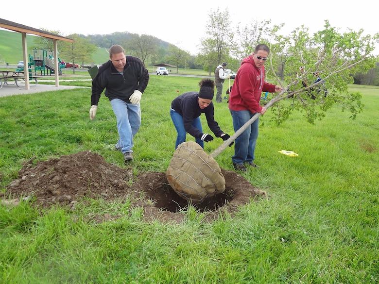 People planting trees.