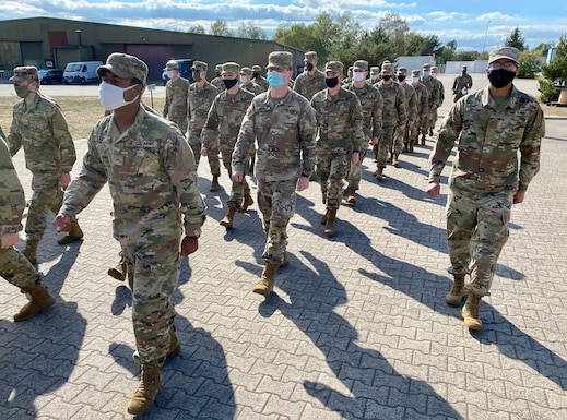 Inbound Soldiers from the United States to Europe, march to lunch at the Deployment Processing Center, Rhine Ordnance Barracks in Kaiserslautern, Germany September 11, 2020. The DPC currently houses incoming personnel from the United States undergoing quarantine and in-processing to the European theater. Task Force Willkommen is a group of organizations facilitating this process during the COVID-19 pandemic. (U.S. Army Reserve photo by Sgt. 1st Class Rick Scavetta/Released)